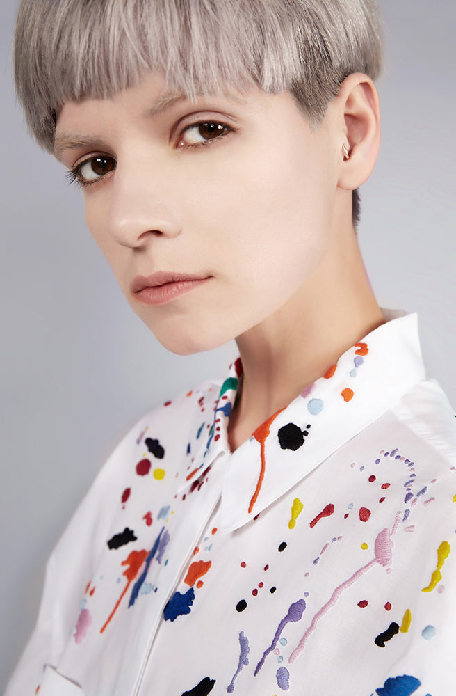 Colourful embroidered paint splashes on crisp white cotton 'cleave' shirt from emerging brand CIMONE. Embellishments and overall look at echoed by Oscar de la Renta one year later in SS18 - be ahead of the trends and support new brands!