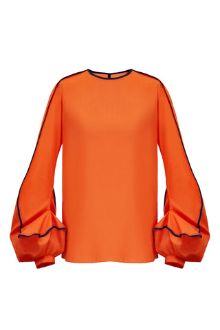 "This blouse has the most unusual cuff detailing. Designed to emulate the swirl of the ""Erupt"" dress, the sleeve is bottom heavy and features two contrasting bound edges, highlighting the erratic movement of the seam work.  This piece has a simple straight, clean fit in the body, with a split seam in the back to open. Available on this page in either orange with navy blue binding, or red with black binding."