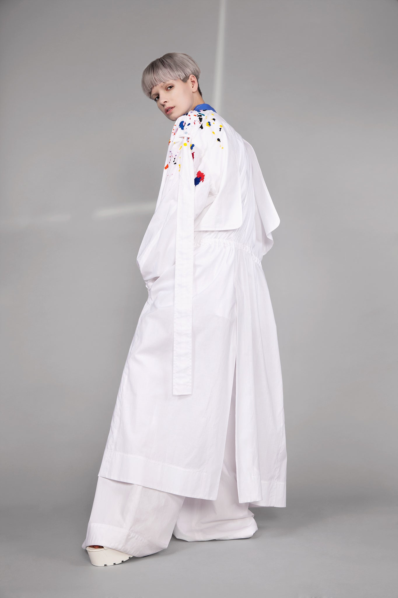 Colourful embroidered paint splashes on crisp white cotton 'Helios' trench coat from emerging brand CIMONE. Embellishments and overall look at echoed by Oscar de la Renta one year later in SS18 - be ahead of the trends and support new brands!