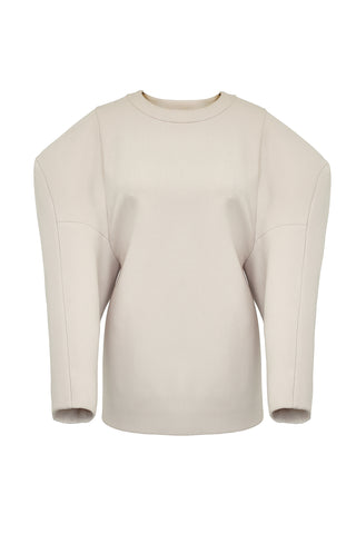 "This casual sweatshirt-style top features gigantic exaggerated sleeves with an unusual dropped shoulder line. The colossal shoulders are enhanced by the clean nature of the body, and share the same sleeve construction as the ""Extra"" coat. The sleeves have been bonded in self, to give them a little more body and sumptuousness.  To close there is a zip in each of the shoulders. The inside is clean with bound seams to finish."
