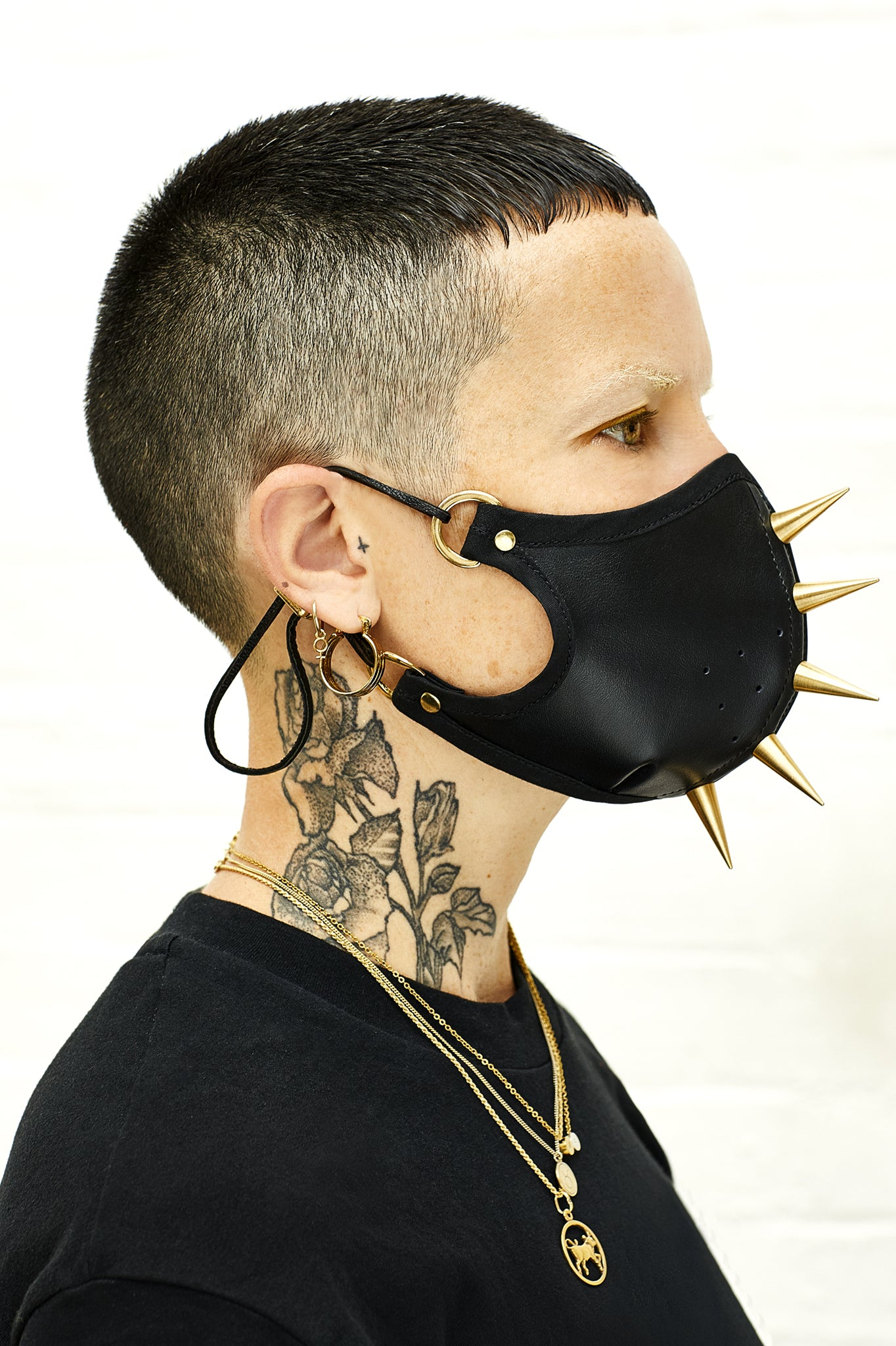Gold studded black leather face mask
