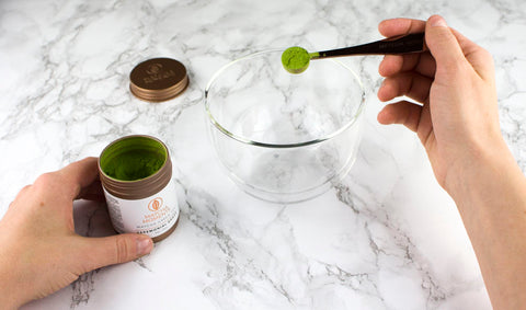 Add 1 g of matcha to a bowl