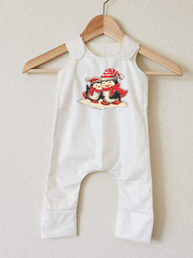 White romper with two penguins on front