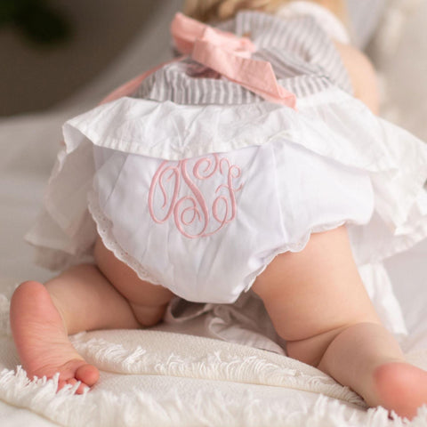 Baby's bottom wearing a monogrammed diaper cover