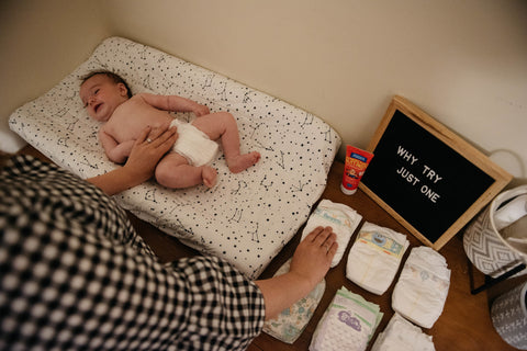 "Baby with diapers, text on board ""why try just one"""