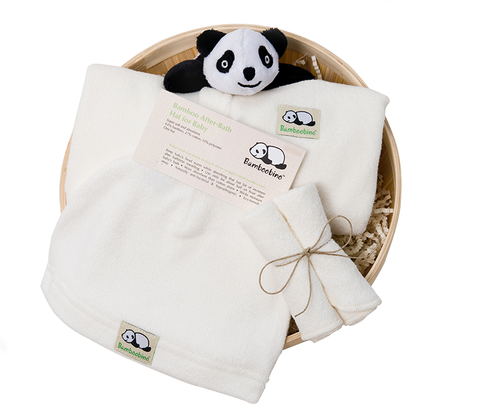 Bamboo basket with hooded baby wrap, washcloths, baby hat and plush panda