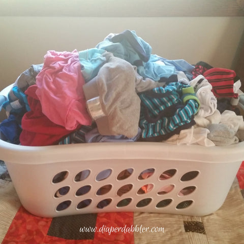 Laundry basket of baby kids clothes