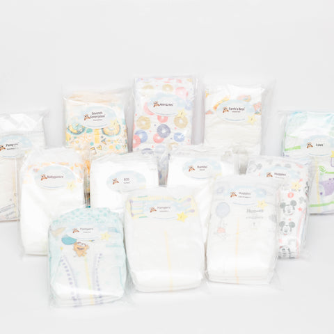Photo of 12 brands of Diaper Samples including Huggies Little Snuggler, Huggies Snug & Dry, Pampers Swaddlers, Pampers Pure Protection, Pampers Baby Dry, Luvs, ABBY&FINN, Bambo Nature, Babyganics, ECO by Naty, Earth's Best and Seventh Generation
