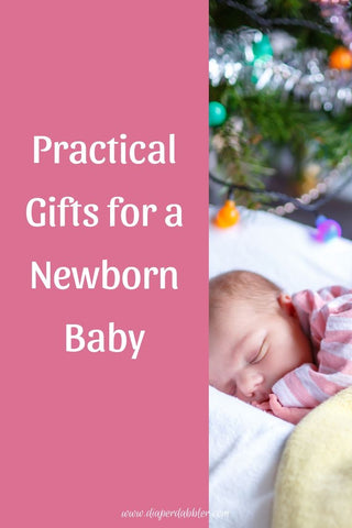 "Baby sleeping under tree with lights, caption ""Practical Gifts for a Newborn Baby"""