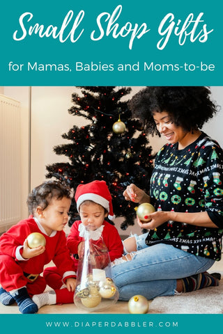"Photo of Mother and two babies in front of a Christmas tree with text ""small shop gifts for mamas, babies and moms to be"""