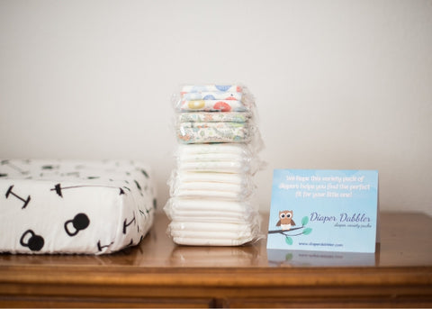 Stack of Diaper Samples with Diaper Brand Rating Card