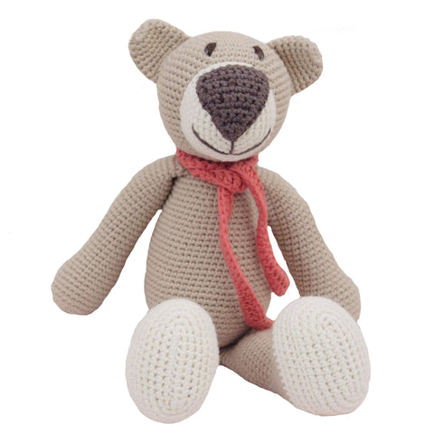 Knit beige bear with brown nose, white feet and a orange/pink scarf