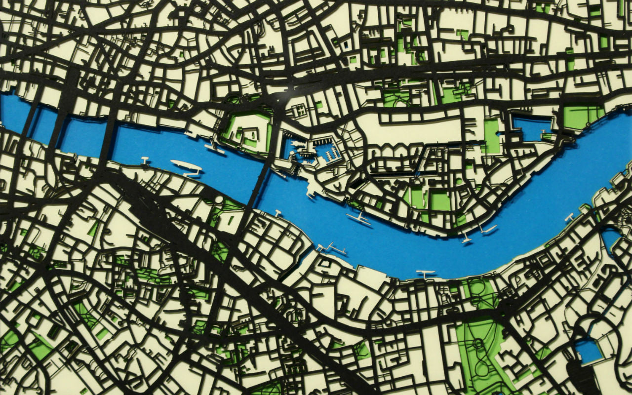 Closeup of a papercut map featuring the river Thames - unique 3D wall art