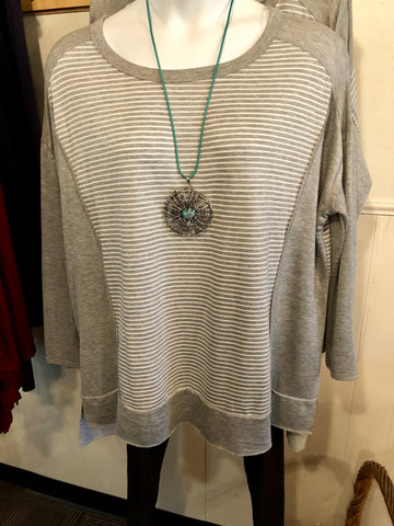 A gain Grey and white light weight top