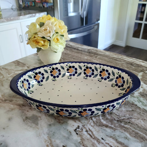 "30 cm/ 11.75"" Oval Baking Dish in Blue Daisy pattern."