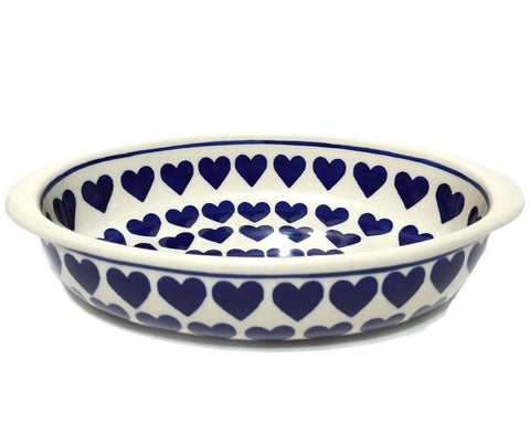 "9"" Oval Baking Dish in Wrapped in Hearts pattern."