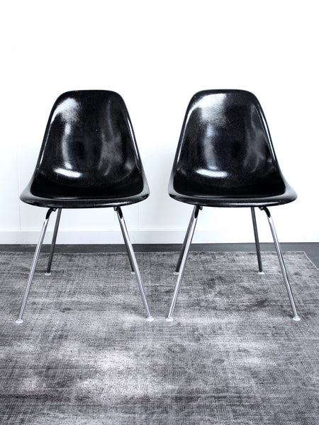 set of 2 black Eames DSX chairs