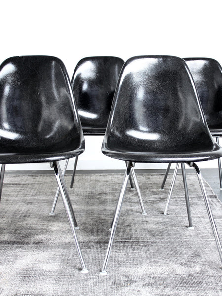 set of 4 black Eames DSX chairs