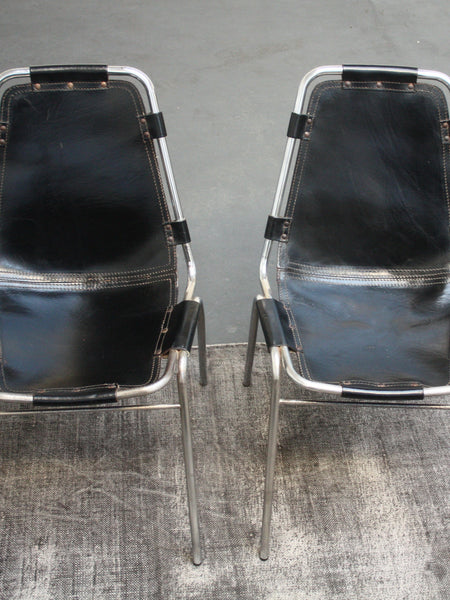 set of 2 black Charlotte Perriand chairs