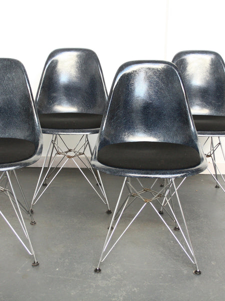 set of 4 navy blue Eames DSR chairs