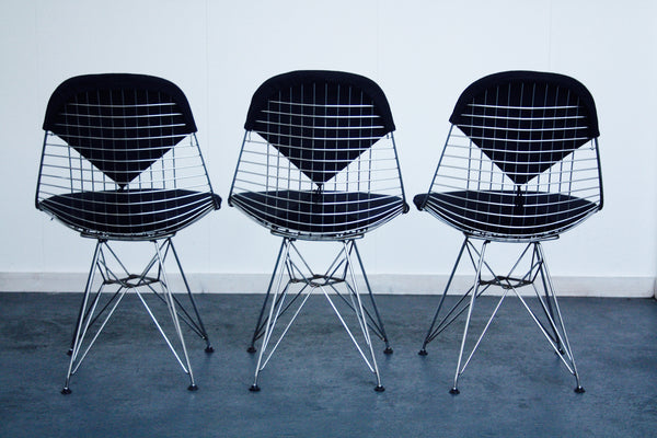 black Eames wire chairs