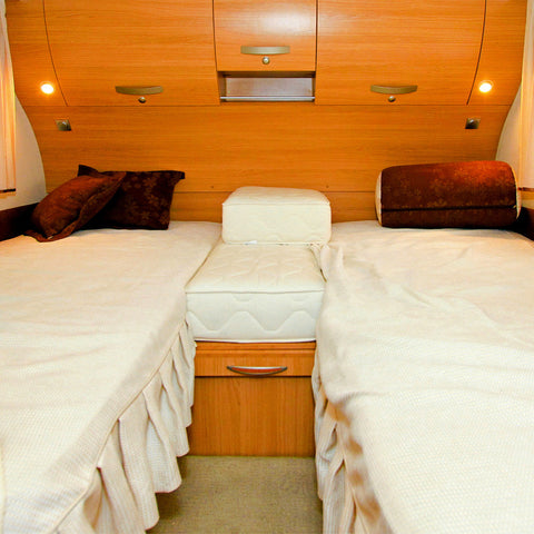 Interior of handsome, wood paneled RV bedroom with 2 bunk beds
