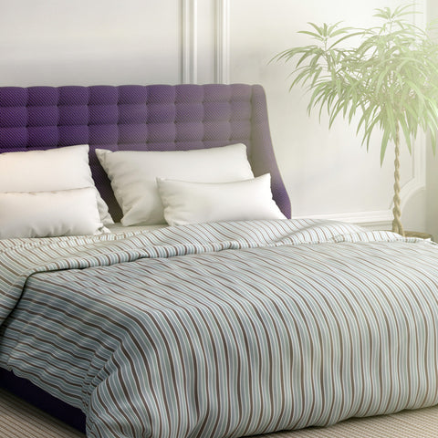 Purple striped duvet cover on bed with contrasting white pillows