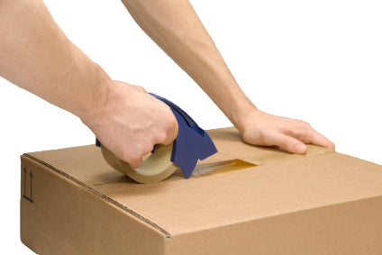 Man taping a box for shipping