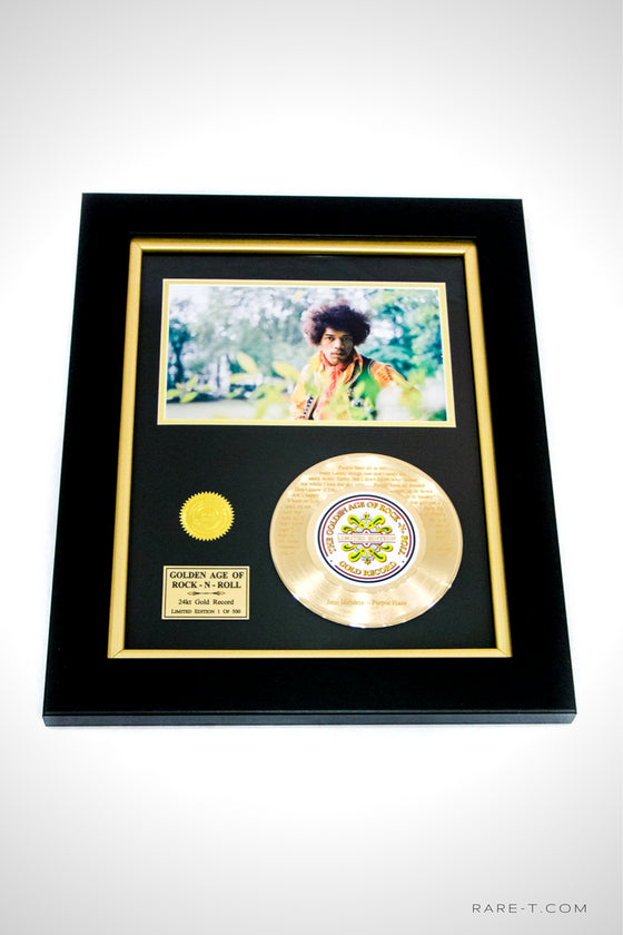 RARE-T Exclusive Limited Edition GOLD 45 'JIMI HENDRIX - PURPLE HAZE LYRICS' custom frame. This deluxe frame is an authentic duplicate of the official gold record award, artwork, seal explaining the contents within to all and the album itself is etched with the iconic song lyrics.