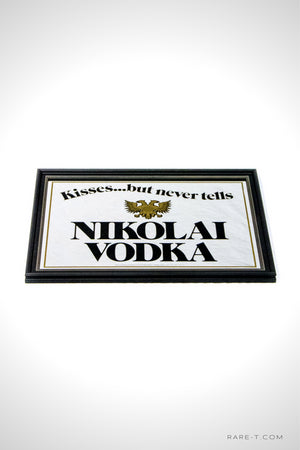 RARE-T | Vintage NIKOLAI VODKA bar advertisement mirror is reversed painted and featuring Seagram double headed Eagle.