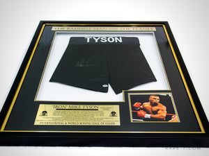 RARE-T Exclusive | A VIP custom shadow box frame displaying boxing trunks signed by 'The Baddest Man' Mike Tyson.