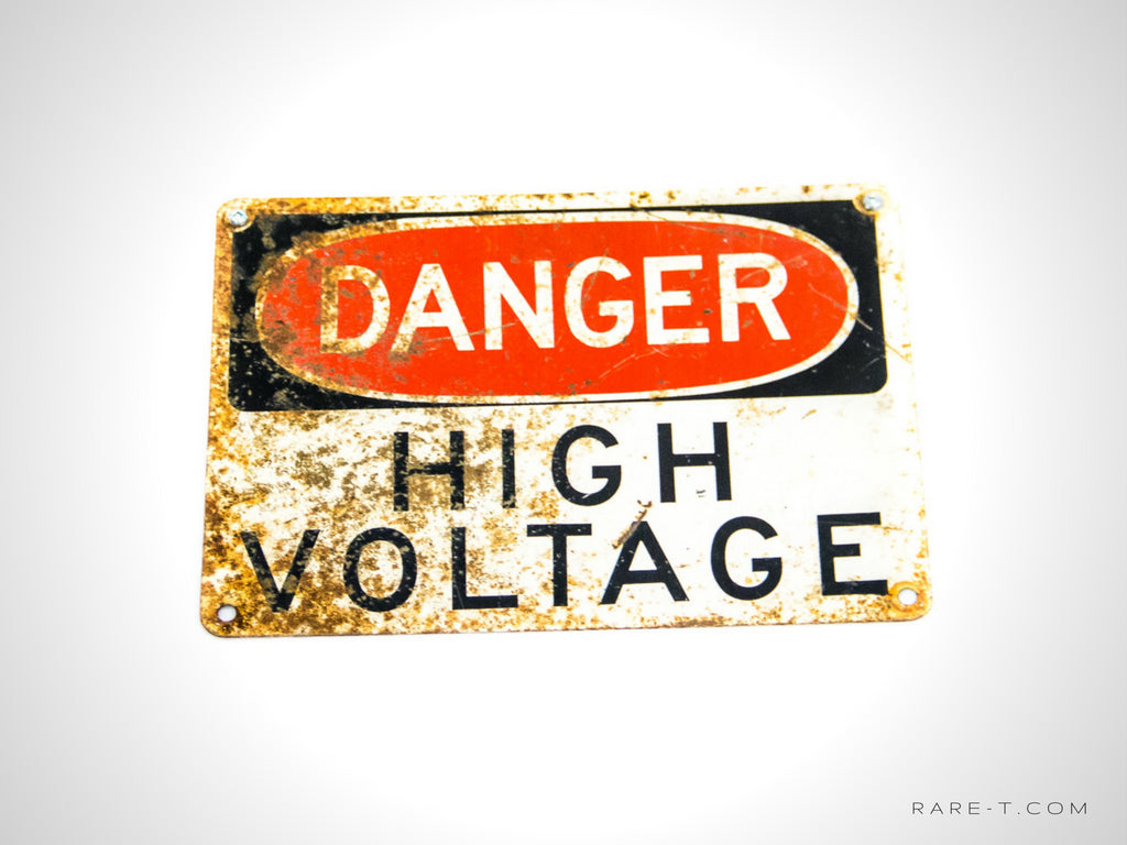 Vintage 'DANGER-HIGH VOLTAGE' Rusty Metal Sign