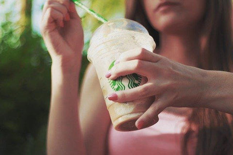 Woman with Starbucks drink