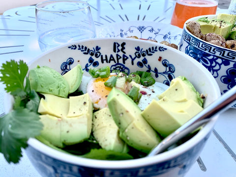Bowl of avocado and an egg