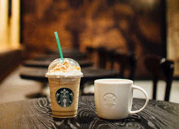 Two Starbucks drinks on a table