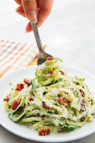 Plate of zoodles alfredo with bacon