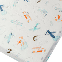 Muslin fitted crib sheet in born to fly.