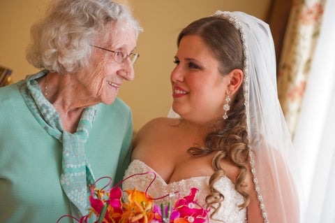 Young woman on her wedding day looking into the eyes of her grandmother