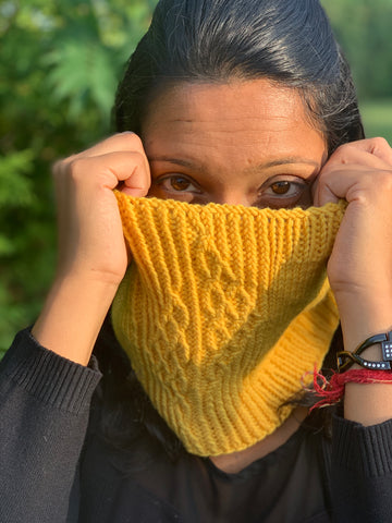 Indian woman models golden yellow knitted cowl