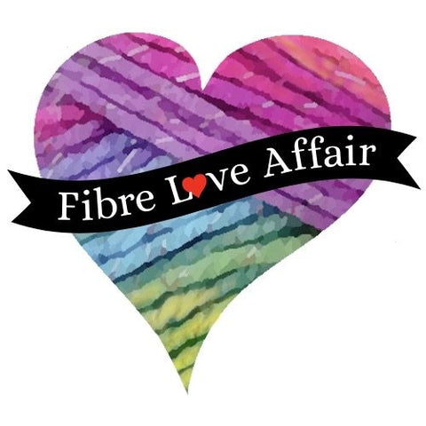 """A photo of yarn is cropped into a heart shape with a black banner across the middle.  The banner reads """"Fibre Love Affair""""."""