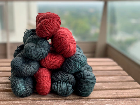 Stack of red and teal yarns