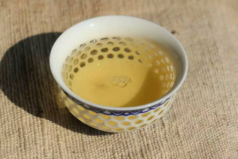 blue cup of puerh tea