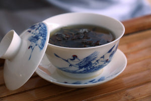 fine pu-erh tea brewed in gaiwan