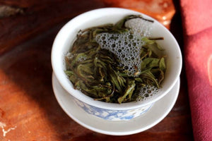 pu-erh tea leaves brewing in a gaiwan
