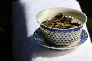 old-growth tea leaves in a beautiful gaiwan