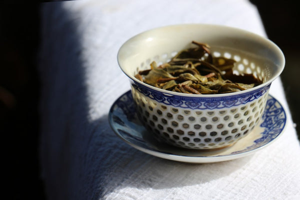 tea leaves in a beautiful blue gaiwan
