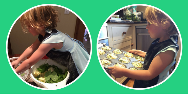 Toddler wearing the Apron making Cheese and Spinach muffin - baby-led weaning recipe