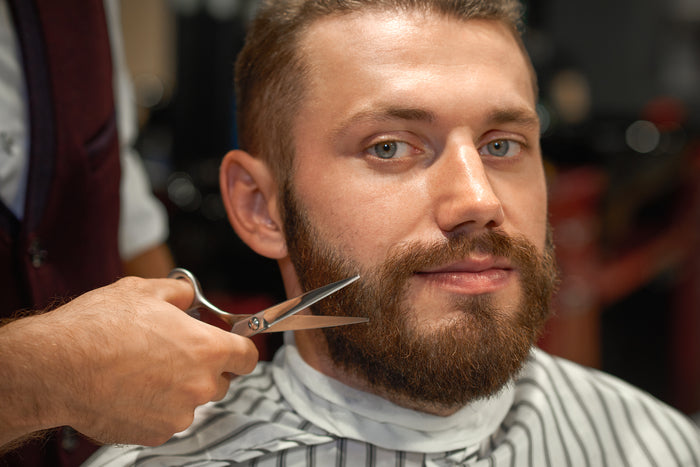 man getting styling of beard