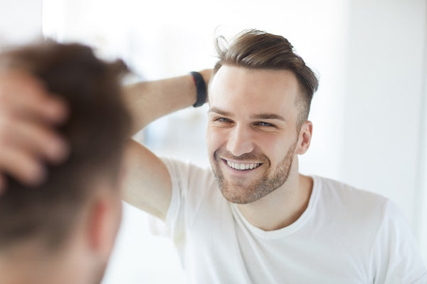 young man styling his hair