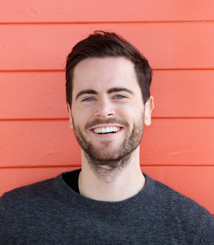 smiling man with a patchy beard